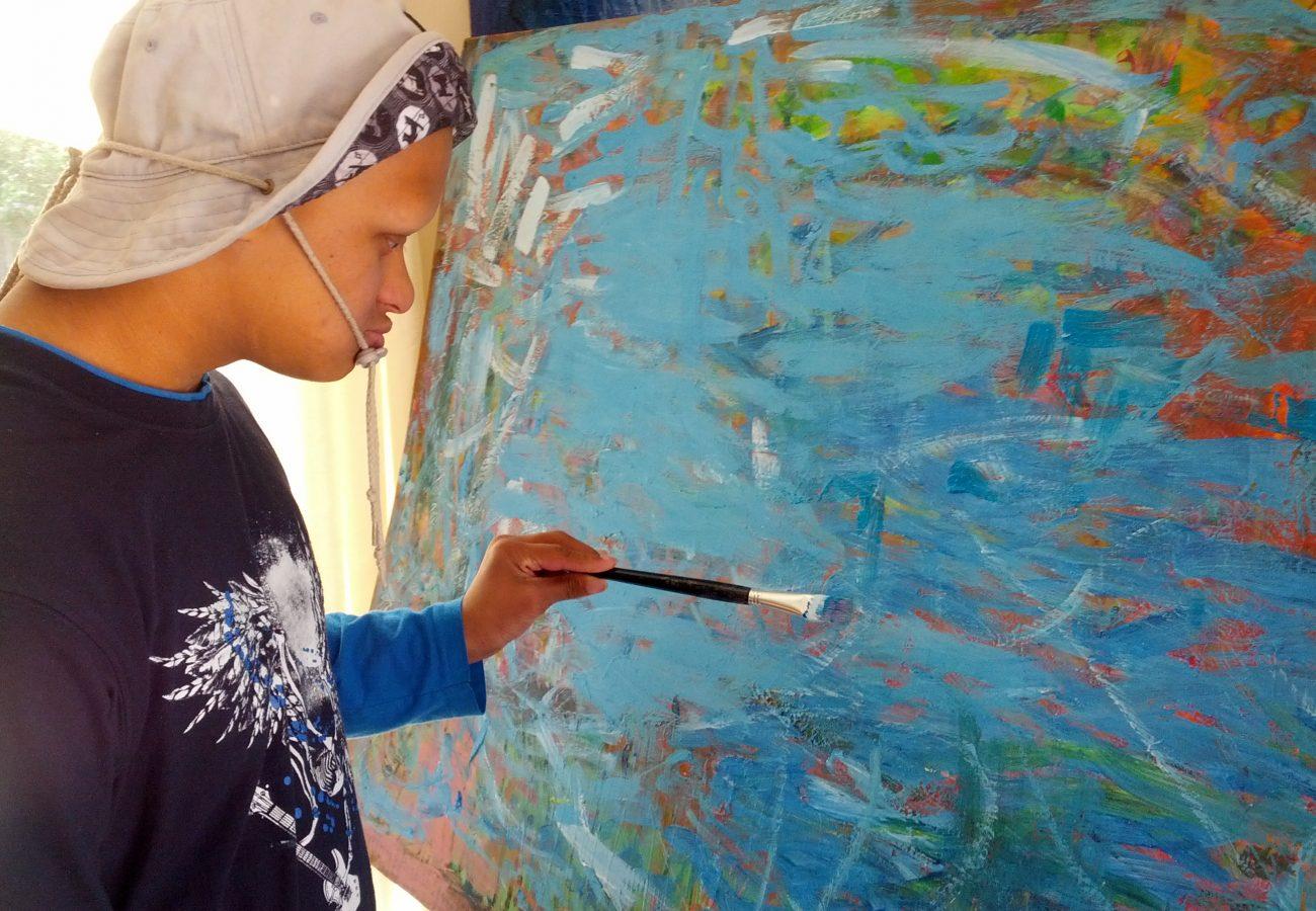 Artist Shamath Perrara in action at Hughes House